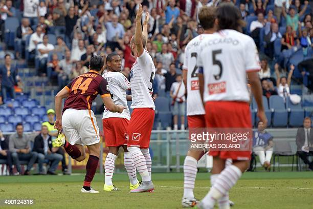 Roma's defender from Greece Kostas Manolas celebrates after scoring during the Italian Serie A football match Roma vs Carpi on September 26 2015 at...