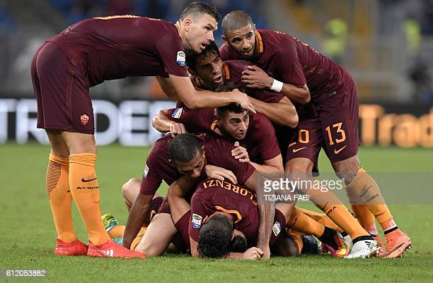 Roma's defender from Greece Kostas Manolas celebrates with teammates after scoring during the Italian Serie A football match AS Roma vs Inter Milan...