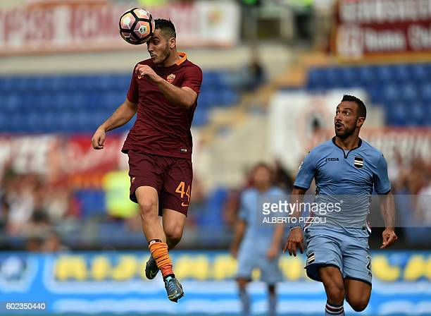 Roma's defender from Greece Kostas Manolas fights for the ball with Sampdoria's forward Fabio Quagliarella during the Italian Serie A football match...