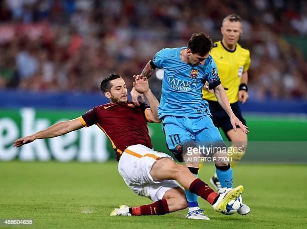 Roma's defender from Greece Kostas Manolas tackles Barcelona's Argentinian forward Lionel Messi during the UEFA Champions League football match...