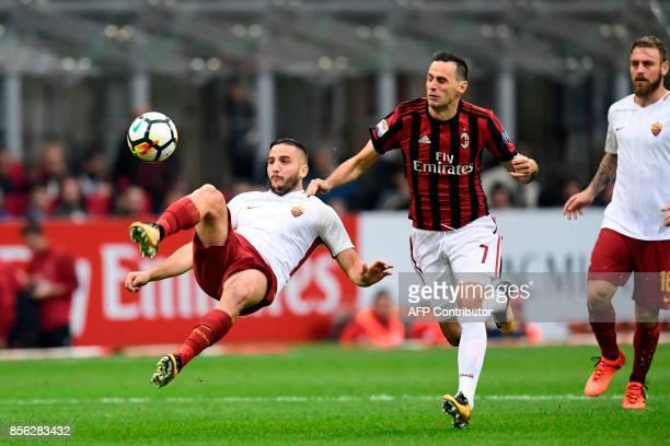AS Roma's defender from Greece Kostas Manolas vies with AC Milan's Craotian forward Nikola Kalinic during the Italian Serie A football match AC Milan...
