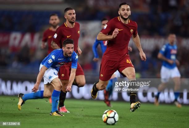 Roma's defender from Greece Kostas Manolas vies with Napoli's Belgian forward Dries Mertens during the Italian Serie A football match Roma vs Napoli...