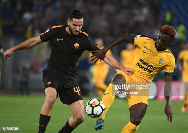 AS Roma's defender from Greece Kostas Manolas vies with Verona's forward from Italy Moise Keen during the Italian Serie A football match AS Roma vs...