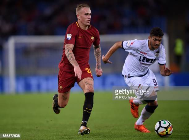 Roma's defender from Netherlands Rick Karsdorp vies with Crotone midfielder Andrea Nalini during the Italian Serie A football match Roma vs Crotone...