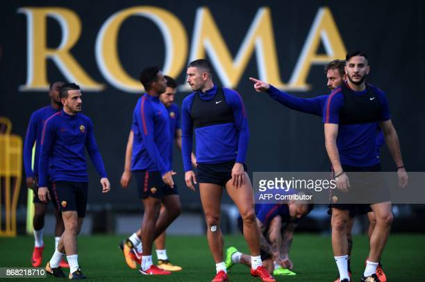 Roma's defender from Serbia Aleksandar Kolarov takes part in a training session with teammates on the eve of the UEFA Champions League football match...