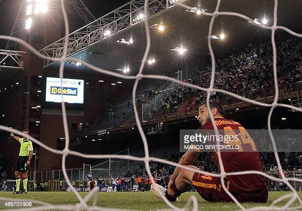 Roma's defender Kostas Manolas from Greece reacts after scoring an own goal during the Italian Serie A football match Sampdoria vs Roma on September...