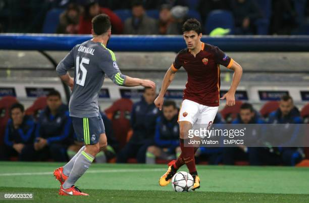 Roma's Diego Perotti takes on Real Madrid's Daniel Carvajal