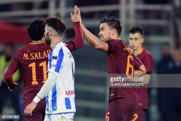 Roma's Dutch midfielder Kevin Strootman celebrates with teammates after scoring a goal during the Italian Serie A football match between Pascara and...