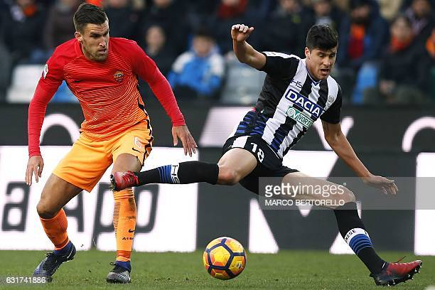 AS Roma's Dutch midfielder Kevin Strootman fights for the ball with Udinese's Croatian forward Stipe Perica during the Italian Serie A football match...