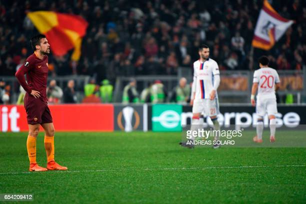 Roma's Dutch midfielder Kevin Strootman reacts at the end of the qualifying UEFA Europa League match AS Roma versus Lyon at Rome's Olympic stadium on...