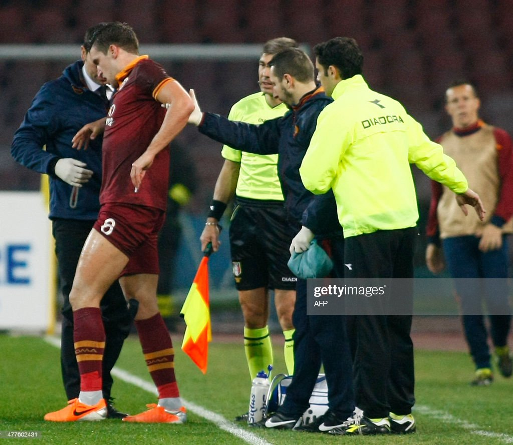 Roma s Dutch midfielder Kevin Strootman L receives medical