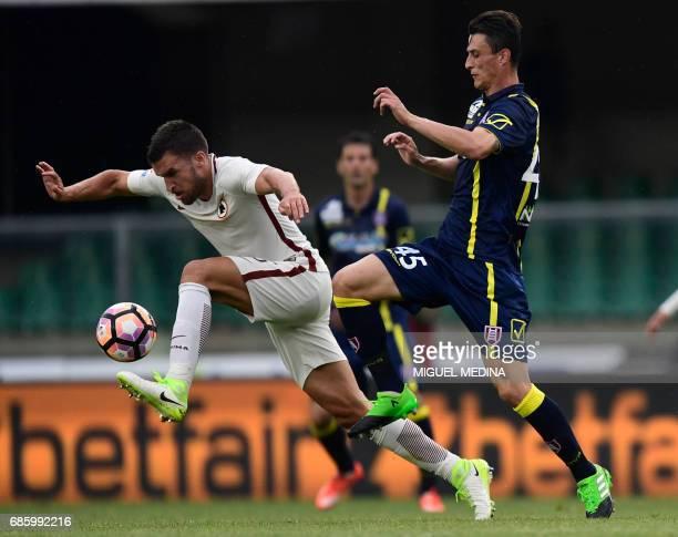 AS Roma's Dutch midfielder Kevin Strootman vies with Chievo's Italian forward Roberto Inglese during the Italian Serie A football match Chievo vs AS...