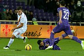 Roma's Dutch midfielder Kevin Strootman vies with Fiorentina's defender Manuel Pasqual during their Serie A football match at the Artemio Franchi...