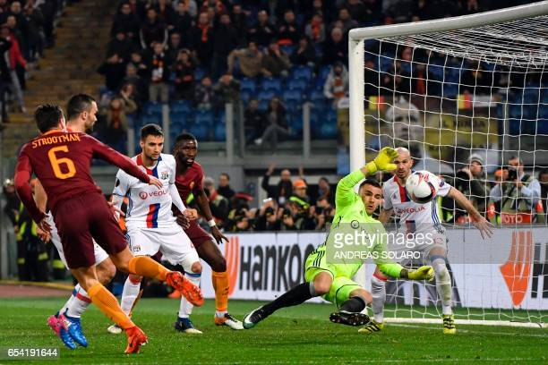 AS Roma's Dutck midfielder Kevin Strootman tries to score a goal in front of Lyon's Portuguese goalkeeper Anthony Lopes during the Europa League...
