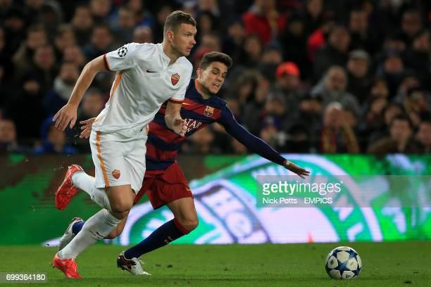 Roma's Edin Dzeko and Barcelona's Marc Bartra