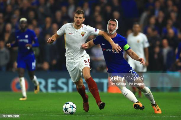 Roma's Edin Dzeko and Chelsea's Gary Cahill battle for the ball during the UEFA Champions League Group C match at Stamford Bridge London