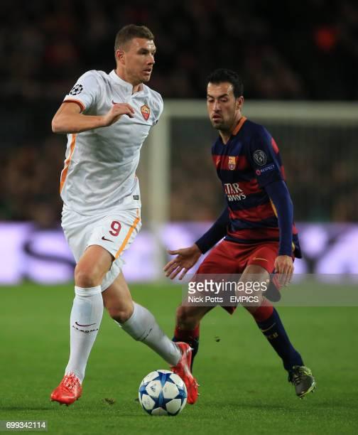 AS Roma's Edin Dzeko holds off Barcelona's Sergio Busquets