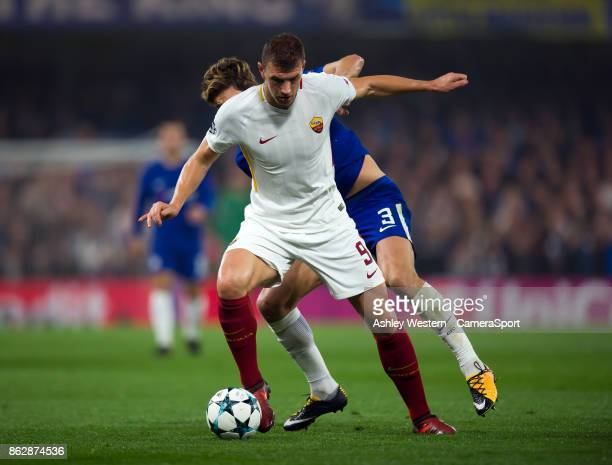 Roma's Edin Dzeko holds off the challenge from Chelsea's Marcos Alonso during the UEFA Champions League group C match between Chelsea FC and AS Roma...