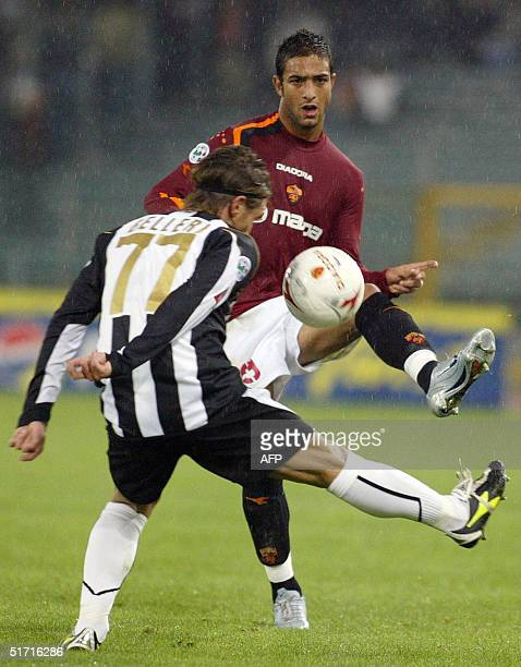 Roma's Egyptian forward Ahmed Mido vies with Udinese's defender Manuel Belleri during their serie A football match at the Olympic stadium in Rome 10...