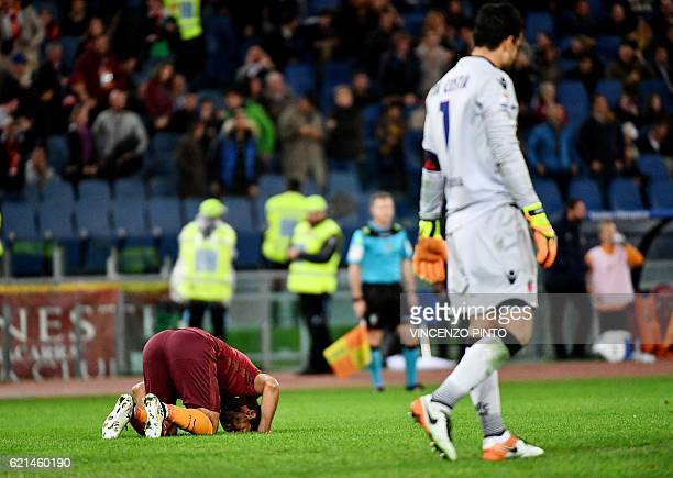 AS Roma's Egyptian forward Mohamed Salah celebrates after scoring against Bologna's goalkeeper from Brazil Angelo Da Costa during the Italian Serie A...
