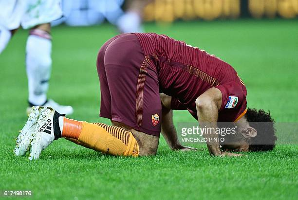 AS Roma's Egyptian forward Mohamed Salah celebrates after scoring during the Serie A football match AS Roma vs Palermo at the Olympic stadium in Rome...
