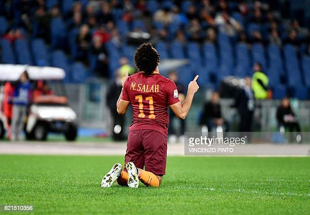 AS Roma's Egyptian forward Mohamed Salah celebrates after scoring during the Italian Serie A football match AS Roma vs Bologna at the Olympic stadium...