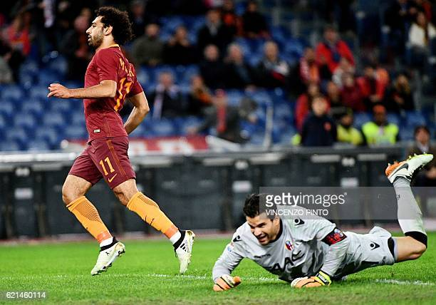 AS Roma's Egyptian forward Mohamed Salah celebrates scores against Bologna's goalkeeper from Brazil Angelo Da Costa during the Italian Serie A...