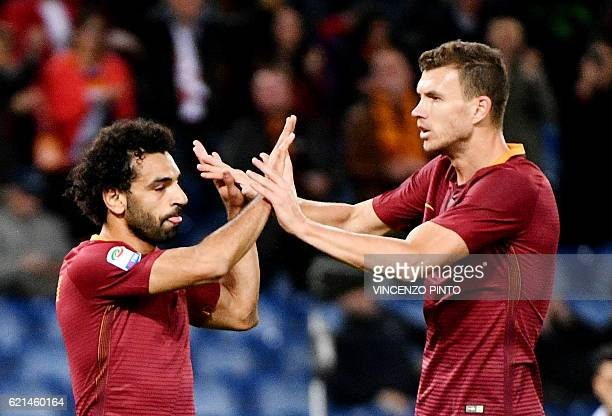 AS Roma's Egyptian forward Mohamed Salah celebrates with teammate AS Roma forward of Bosnia Edin Dzeko after scoring during the Italian Serie A...