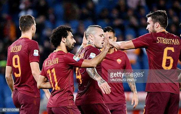 AS Roma's Egyptian forward Mohamed Salah celebrates with teammates after scoring during the Italian Serie A football match AS Roma vs Bologna at the...