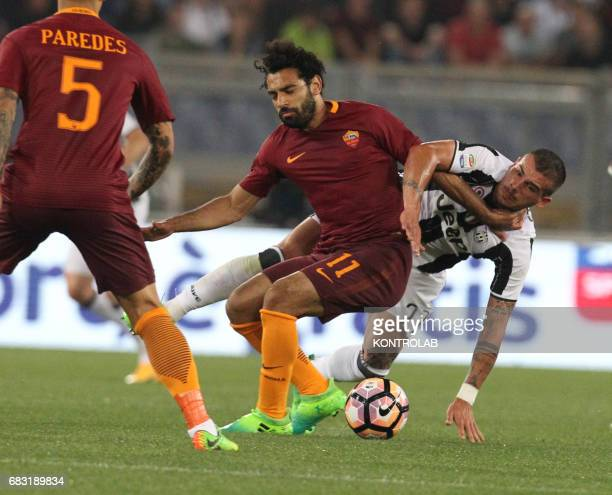 Roma's Egyptian forward Mohamed Salah fights for the ball with Juventus' midfielder from Italy Stefano Sturaro during the Italian Serie A football...