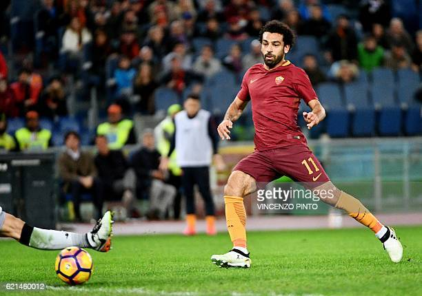 AS Roma's Egyptian forward Mohamed Salah scores during the Italian Serie A football match AS Roma vs Bologna at the Olympic stadium in Rome on...