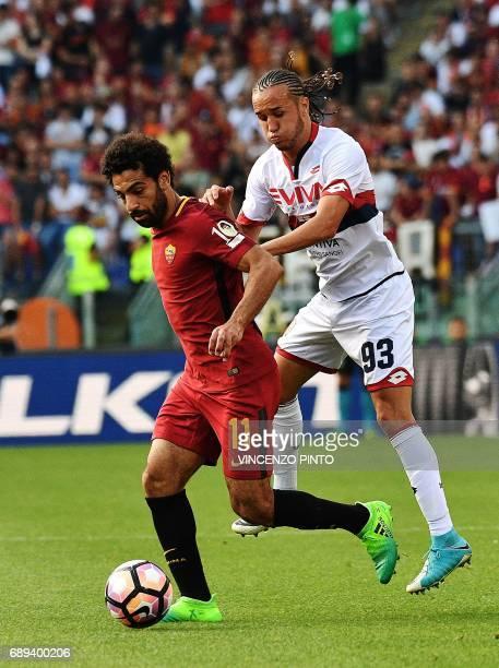 AS Roma's Egyptian forward Mohamed Salah vies Genoa's Uruguayan midfielder Diego Laxalt during the Italian Serie A football match AS Roma vs Genoa on...