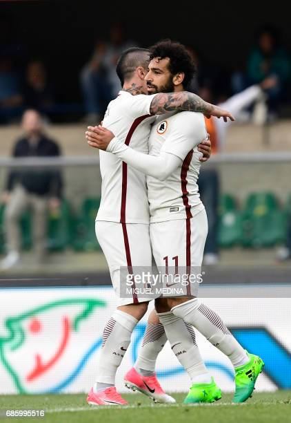 AS Roma's Egyptian midfielder Mohamed Salah celebrates with AS Roma's Belgium midfielder Radja Nainggolan after scoring during the Italian Serie A...