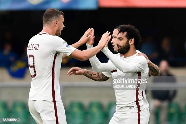 AS Roma's Egyptian midfielder Mohamed Salah celebrates with AS Roma's Belgium midfielder Radja Nainggolan and Roma's forward from BosniaHerzegovina...