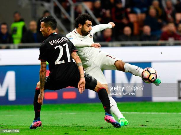 AS Roma's Egyptian midfielder Salah vies with AC Milan's Argentinian defender Leonel Vangioni during the Italian Serie A football match AC Milan vs...