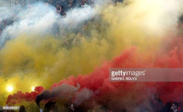 AS Roma's fans cheer during the Italian Serie A football derby between Lazio Rome and AS Roma on February 9 2014 at the Olympic stadium in Rome AFP...