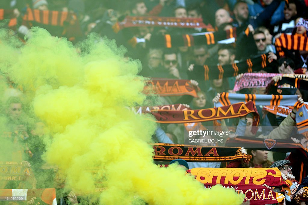 AS Roma's fans cheer their team prior the Italian Serie A football match between AS Roma and Fiorentina on December 8, 2013 at the Olympic stadium in Rome.