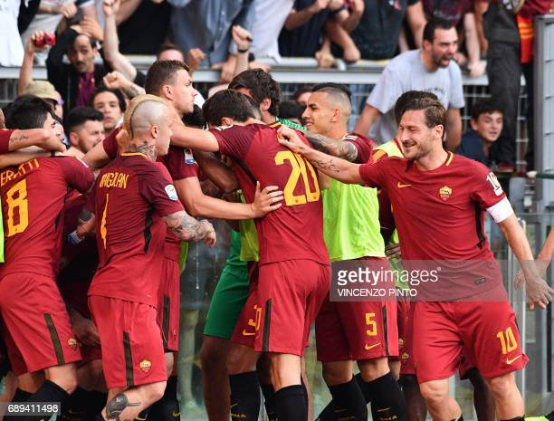 AS Roma's forward and captain Francesco Totti celebrates with teammates after a goal by AS Roma's midfielder Daniele De Rossi during the Italian...