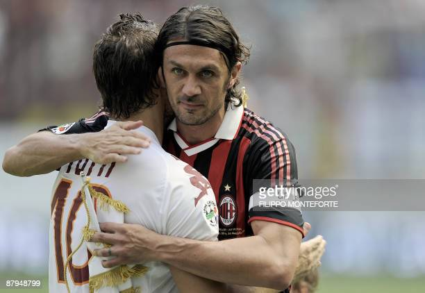 AS Roma's forward and captain Francesco Totti hugs AC Milan's defender and captain Paolo Maldini before their Serie A football match in Milan San...