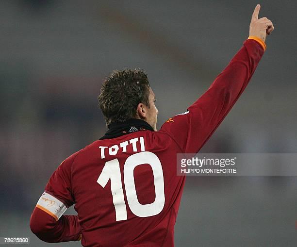 AS Roma's forward and captain Francesco Totti jubilates after scoring a penalty kick against Sampdoria during their Serie A football match in Rome's...