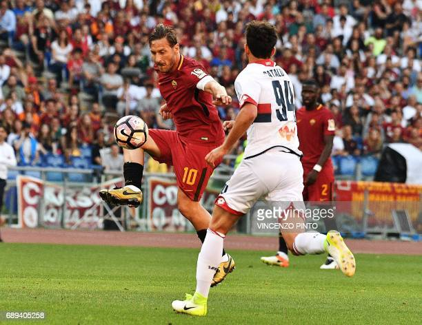 AS Roma's forward and captain Francesco Totti vies with Genoa's defender Pietro Pellegri during the Italian Serie A football match AS Roma vs Genoa...
