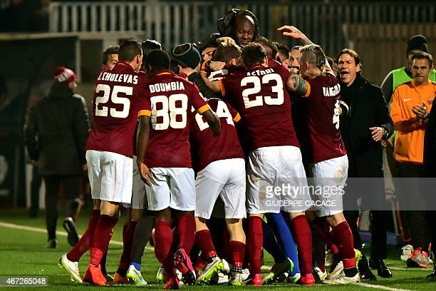 Roma's forward Daniele De Rossi celebrates with teammates after scoring during the Italian Serie A football match Cesena vs Roma at 'Dino Manuzzi'...