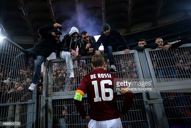 Roma's forward Daniele De Rossi talks to the fans after being defeated 03 during the Europa League Round of 16 second leg football match Roma vs...