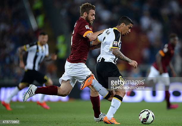 Roma's forward Daniele De Rossi vies with Udinese's Brazilian midfielder from Allan during the Serie A football match between Roma and Udinese on May...