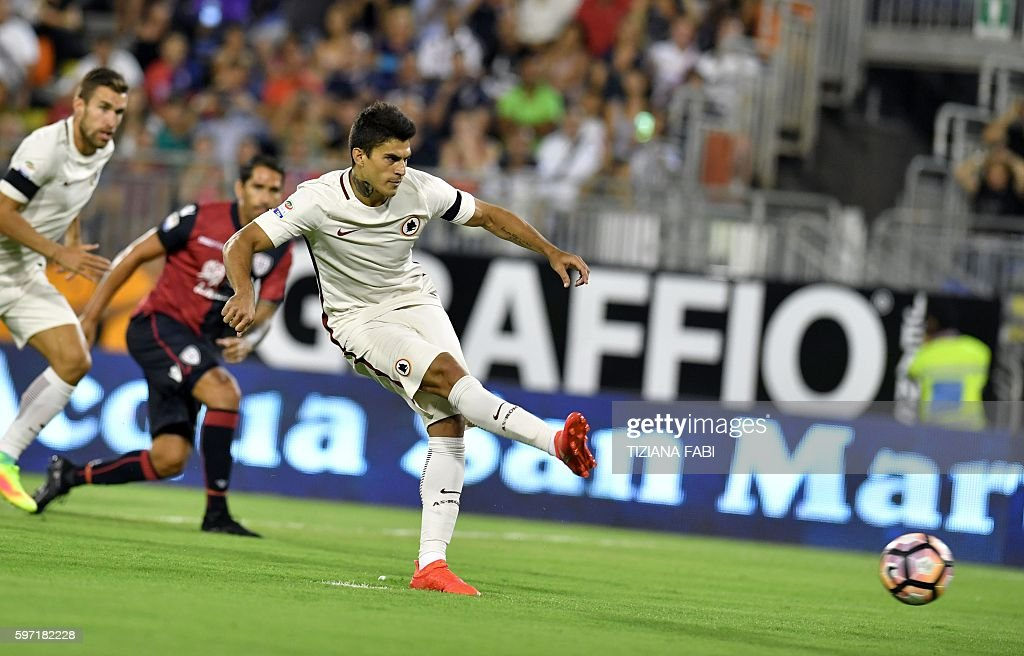 Roma's forward Diego Perrotti kicks the ball to score a goal during the Serie A football match between Cagliari and Roma at the Sant'Elia stadium in...