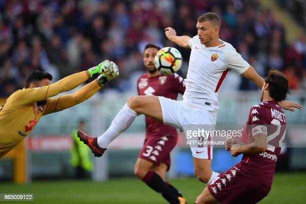 AS Roma's forward Edin Dzeko from BosniaHerzegovina fights for the ball with Torino's goalkeeper Salvatore Sirigu during the Italian Serie A football...