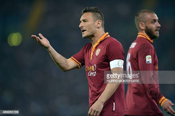 AS Roma's forward Francesco Totti and midfielder Daniele De Rossi react during the Italian Serie A football match between AS Roma and AC Milan on...