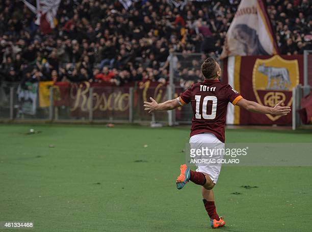 Roma's forward Francesco Totti celebrates after scoring a second goal during the Italian Serie A football match on January 11 2015 at Rome's Olympic...