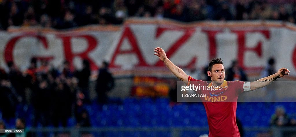AS Roma's forward Francesco Totti celebrates after scoring during the Italian Serie A football match AS Romsa vs Genoa at Olympic Stadium on March 3, 2013 in Rome.