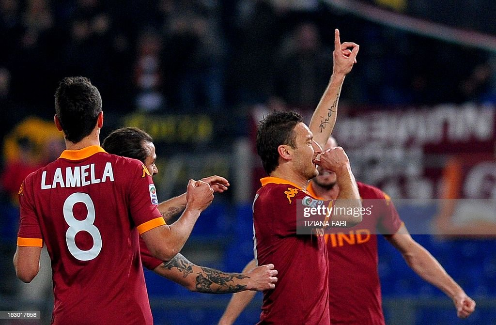 AS Roma's forward Francesco Totti (R) celebrates after scoring during the Italian Serie A football match AS Romsa vs Genoa at Olympic Stadium on March 3, 2013 in Rome.